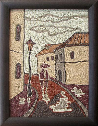 Картина из кожаных жгутов